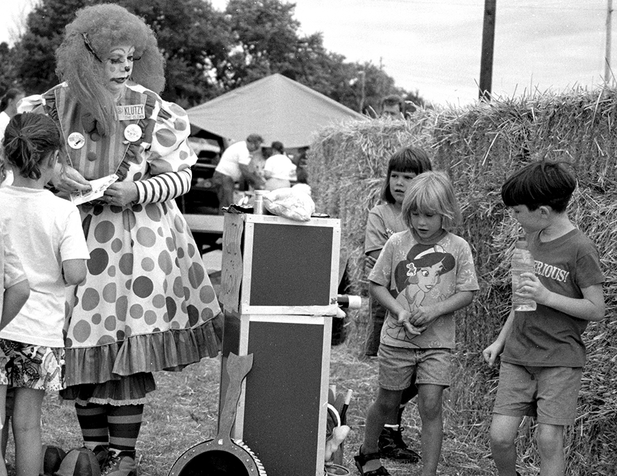 Kids Seeing the secrets of Klutzy the Clowns magic act.