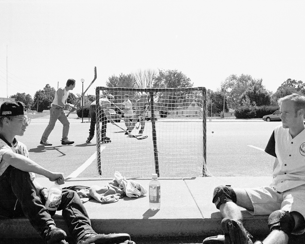 A Hockey game in a parking lot