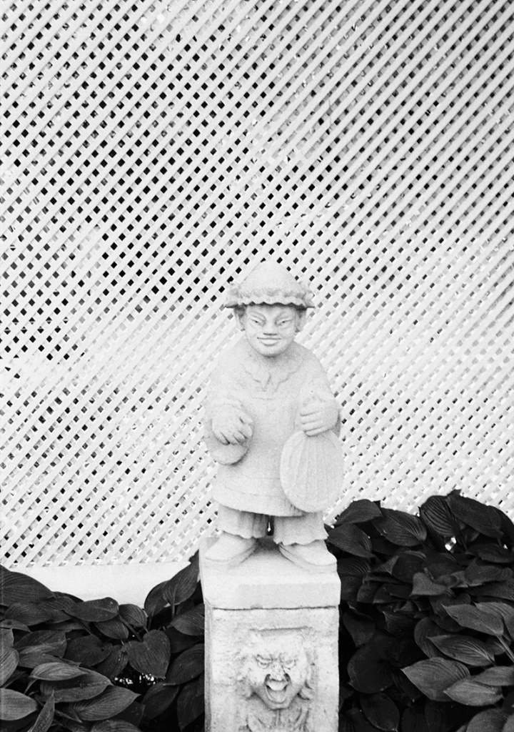 Statue in front of fence at Alerton Park